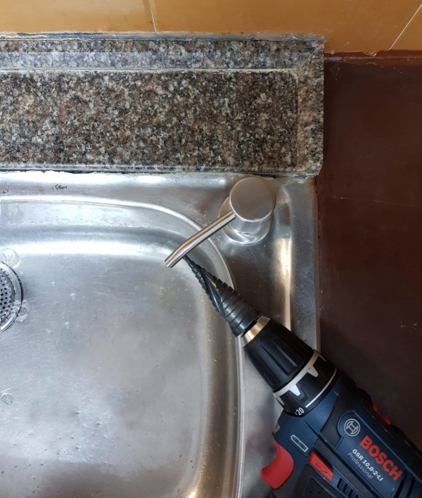 adding soap dispenser to a stainless sink